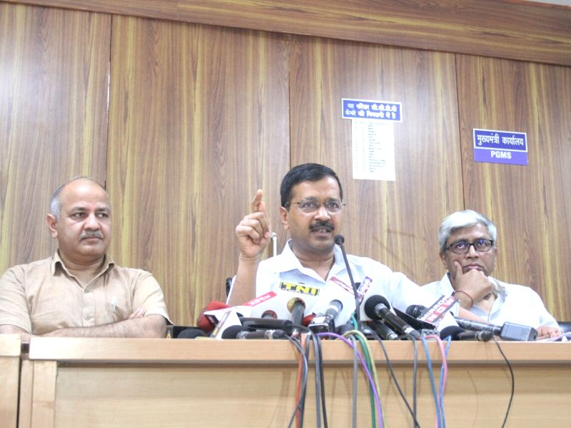AAP leader Arvind Kejriwal addresses a press conference called to release party's manifesto for Delhi MCD Polls in New Delhi, on April 19, 2017. Also seen party leaders Manish Sisodia and ... - Arvind Kejriwal