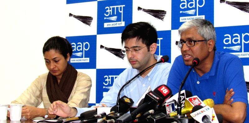 AAP leader Ashutosh addresses a press conference in New Delhi on July 27, 2016. Also seen AAP leaders Alka Lamba and Raghav Chadha.