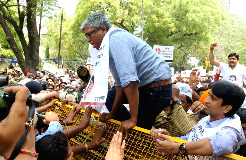 AAP leader Ashutosh with party workers stage a demonstration against central government for not taking action against AgustaWestland scam suspects in New Delhi on May 7, 2016.