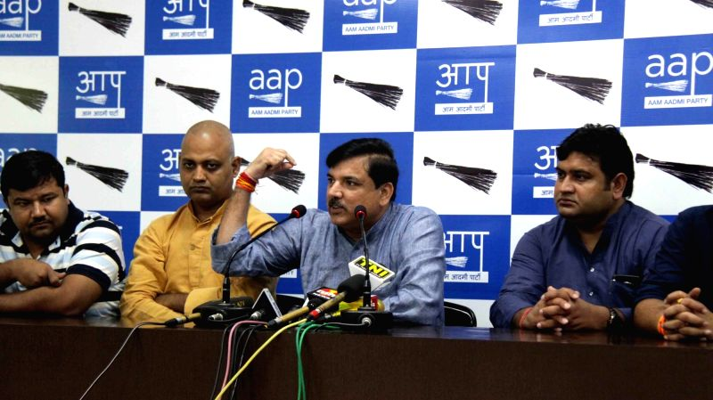 AAP leader Sanjay Singh addresses a press conference in New Delhi on Aug. 6, 2016. Also seen AAP leader Somnath Bharti. - Sanjay Singh