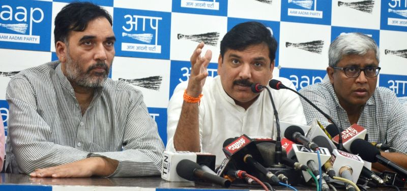 AAP leader Sanjay Singh addresses a press conference in New Delhi on May 20, 2017. Also seen AAP leaders Ashutosh and Gopal Rai. - Sanjay Singh and Gopal Rai