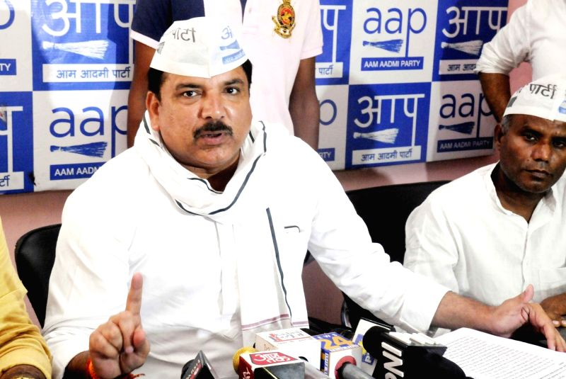 AAP leader Sanjay Singh addresses a press conference at the party office, in Patna on July 21, 2018. - Sanjay Singh