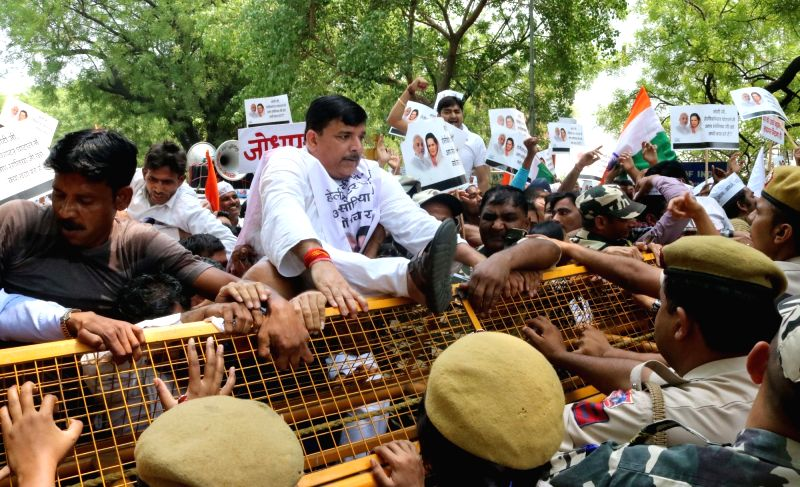 AAP leader Sanjay Singh with party workers stage a demonstration against central government for not taking action against AgustaWestland scam suspects in New Delhi on May 7, 2016. - Sanjay Singh