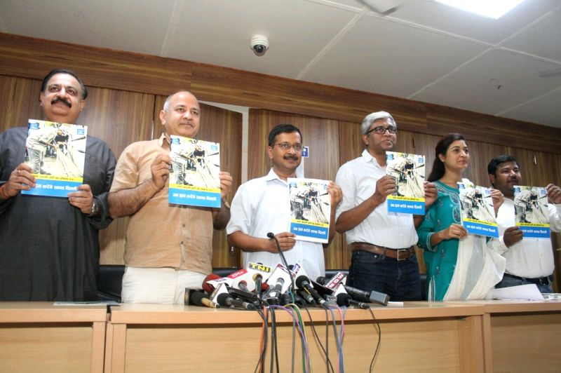 AAP leaders Arvind Kejriwal, Ashutosh, Manish Sisodia and others release party's manifesto for Delhi MCD Polls in New Delhi, on April 19, 2017. Also seen party leaders Manish Sisodia and ... - Arvind Kejriwal