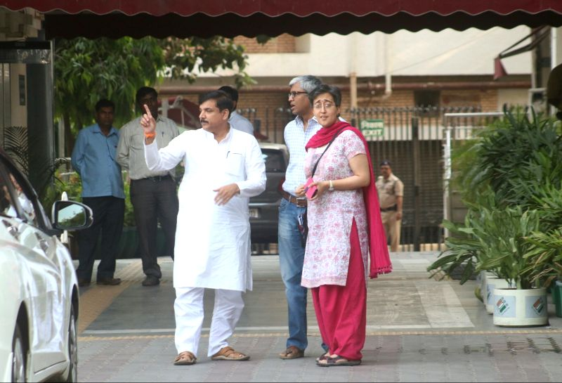 AAP leaders Sanjay Singh, Ashutosh and  Atishi Marlena come out after meeting Election Commissioner in New Delhi on May 24, 2017. - Sanjay Singh