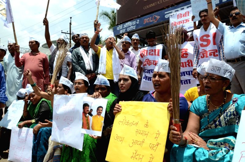 AAP leaders stage a demonstration against BJP leaders in Bhopal on May 21, 2017.