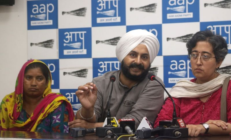 AAP MLA Jarnail Singh and Atishi Marlena address a press conference in New Delhi on July 2+, 2018. - Jarnail Singh