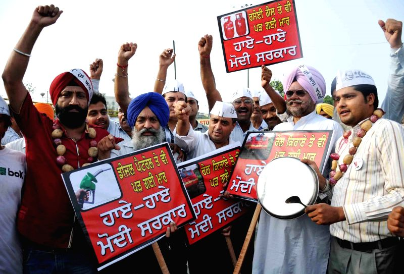 AAP party workers holding a protest against inflation in Amritsar on July 5, 2014.