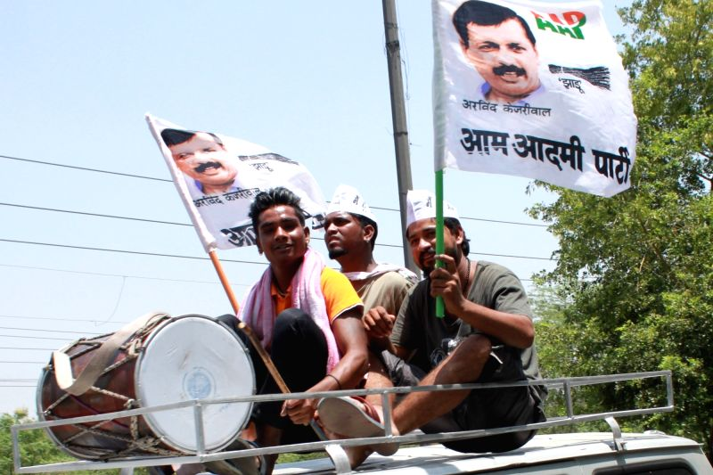 AAP workers celebrate victory of party leader Anil Malik who won from Nanakpura ward in the the recently concluded Municipal Corporation of Delhi (MCD) by-polls in New Delhi, on May 17, ... - Malik