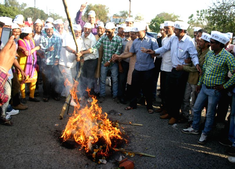 AAP workers perform mock a funeral of the Central Government as they demonstrate against land acquisition ordinance in Bhopal, on Feb 24, 2015.