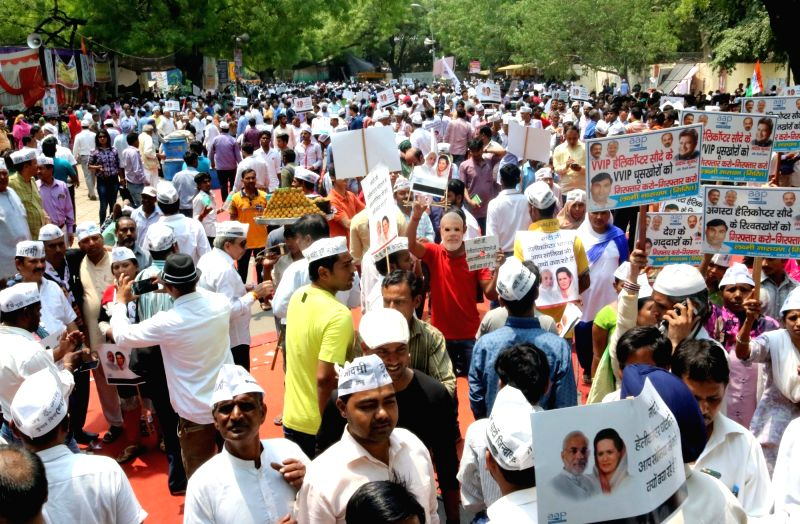 AAP workers stage a demonstration against central government for not taking action against AgustaWestland scam suspects in New Delhi on May 7, 2016.