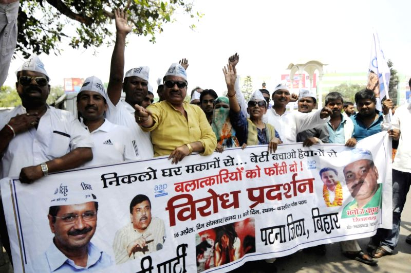AAP workers stage a demonstration demanding death penalty for rapists in Patna, on April 16, 2018.