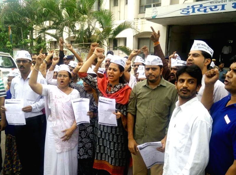 AAP workers stage a demonstration in front of Congress party office in Bhopal, on July 18, 2016.