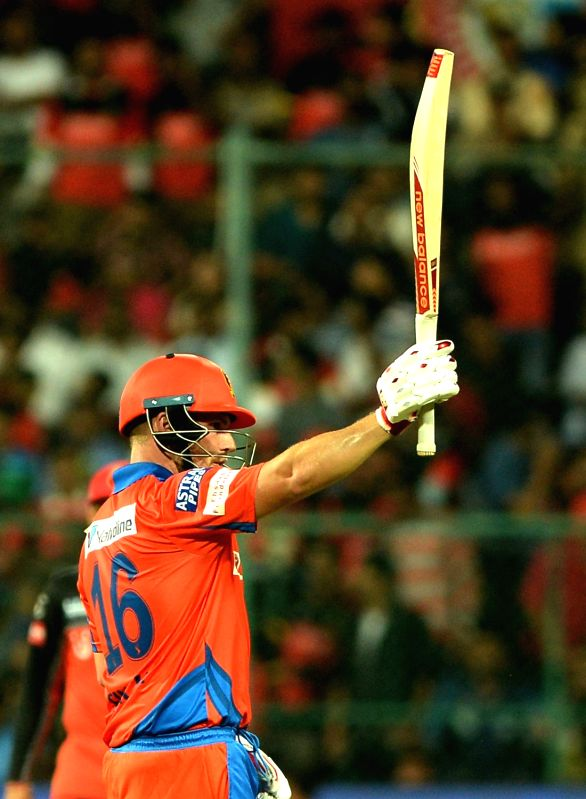 Aaron Finch of Gujarat Lions celebrates his half century during an IPL 2017 match between Gujarat Lions and Royal Challengers Bangalore at M Chinnaswamy Stadium in Bengaluru on April 27, ...