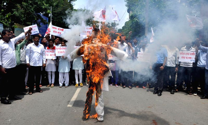 AASU activists burn effigy of Assam Chief Minister Tarun Gogoi against police after two people were killed in a police firing near Assam-Nagaland border in Golaghat district of Assam, in Guwahati on . - Tarun Gogoi