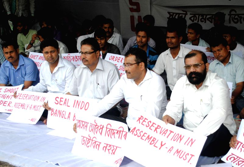 AASU activists led by AASU advisor Samujjal Kumar Bhattacharjee stage a demonstration in Guwahati on Aug 14, 2014. - Samujjal Kumar Bhattacharjee