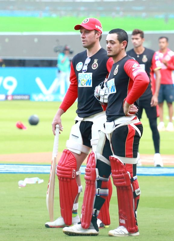 AB de Villiers and Quinton de Kock of Royal Challengers Bangalore during a practice session at M. Chinnaswamy Stadium in Bengaluru on April 12, 2018.
