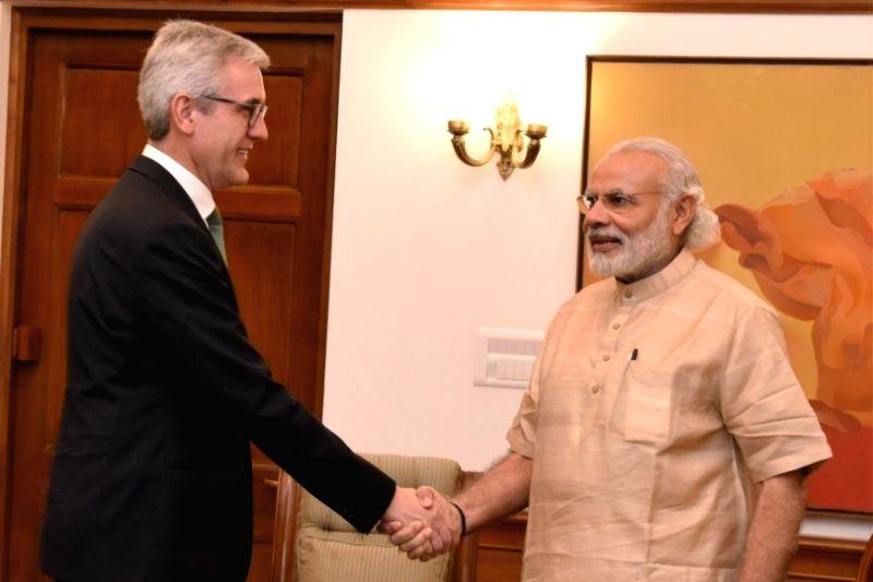 ABB Group CEO Ulrich Spiesshofer calls on Prime Minister Narendra Modi in New Delhi on April 5, 2016. - Narendra Modi