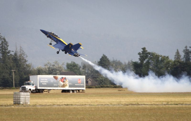 ABBOTSFORD, Aug. 11, 2018 - An aircraft takes off during an aerobatic performance in the 56th Abbotsford International Airshow in Abbotsford, Canada, Aug. 10, 2018. The Abbotsford International ...
