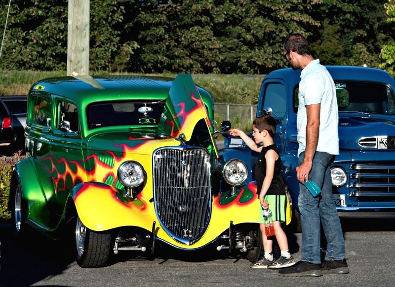 ABBOTSFORD, July 13, 2018 - People look at classic restored cars during the community car show hosted by garages in Abbotsford, Canada, July 12, 2018.