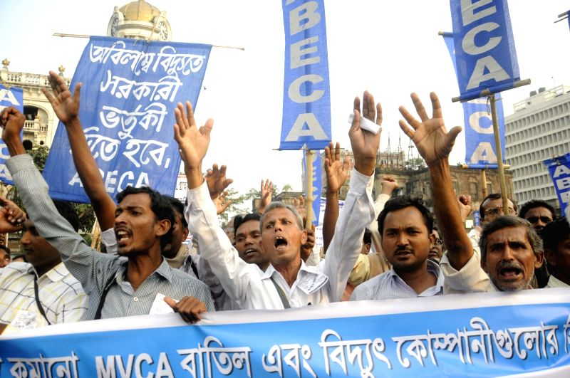 ABECA (All Bengal Electricity Consumers' Association) members participate in a law violation programme against hike in electricity tariff in Kolkata, on Nov 19, 2015.