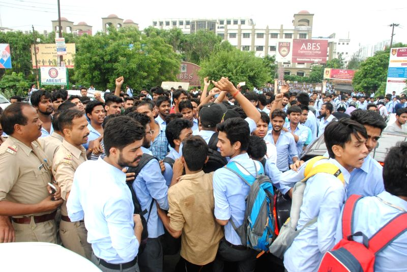 ABES Engineering College students stage a demonstration against the college management and stopped traffic on NH-24; in Ghaziabad on July 27, 2016. An engineering student of ABES ...