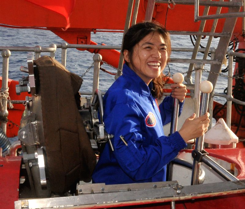 ABOARD XIANGYANGHONG 09, Jan. 10, 2015 Zhang Yi, China's first female pilot trainee for deep-sea manned sub, smiles before entering Jiaolong, China's deep-sea manned submersible, in the ..