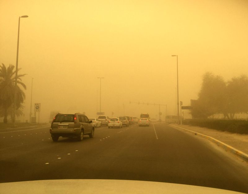 Photo taken on April 2, 2015 shows the street view amid a sand storm in Abu Dhabi, capital of the United Arab Emirates (UAE). The sand storm originated from ...