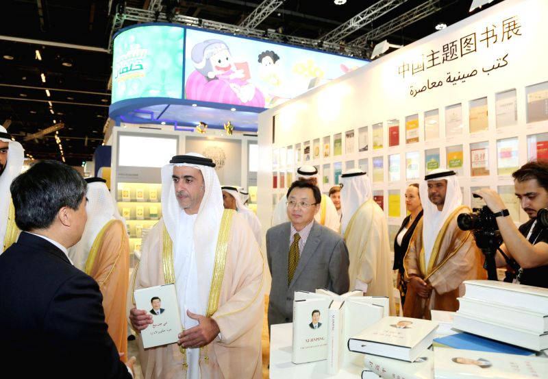 ABU DHABI, April 28, 2017 - Sheikh Saif bin Zayed Al-Nahyan (2nd L), deputy prime minister and interior minister the United Arab Emirates (UAE), views the Arabic edition of Chinese President Xi ...