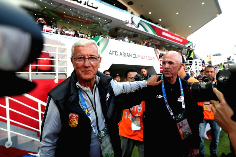 ABU DHABI, Jan. 11, 2019 - Head Coach Marcello Lippi (L) of China and Sven Goran Eriksson of the Philippines react before the 2019 AFC Asian Cup UAE 2019 group C match between China and the ...