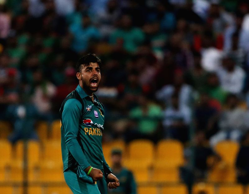 Abu Dhabi: Pakistan's Shadab Khan celebrates fall of Imrul Kayes's wicket during the sixth match of Asia Cup 2018 Super Four between Bangladesh and Pakistan at Sheikh Zayed Stadium in Abu Dhabi, UAE on Sept 26, 2018. (Photo: Surjeet Yadav/IANS)