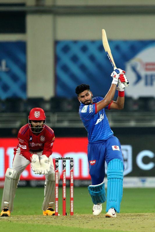 Abu Dhabi: Shreyas Iyer captain of Delhi Capitals hits over the top for six during match 2 of season 13 of Dream 11 Indian Premier League (IPL) between Delhi Capitals and Kings XI Punjab held at the Dubai International Cricket Stadium, Dubai in the U
