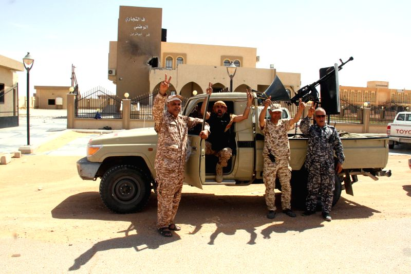 ABU QURAYN, May 19, 2016 - Members of the Libyan army react in Abu Qurayn, about 300 kilometers east of the capital Tripoli, May 18, 2016. Libyan army has recaptured the area from the Islamic State ...