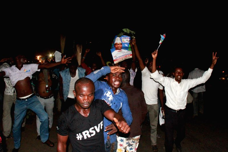 People celebrate the win of Buhari in the presidential election on the street of Abuja, April 1, 2015. Muhammadu Buhari, candidate of Nigeria's opposition All ...