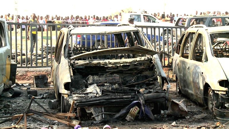 Damaged vehicles are seen at the blast site in Nigeria's capital city Abuja on April 14, 2014. 71 people were killed and 124 people were injured in the morning ...