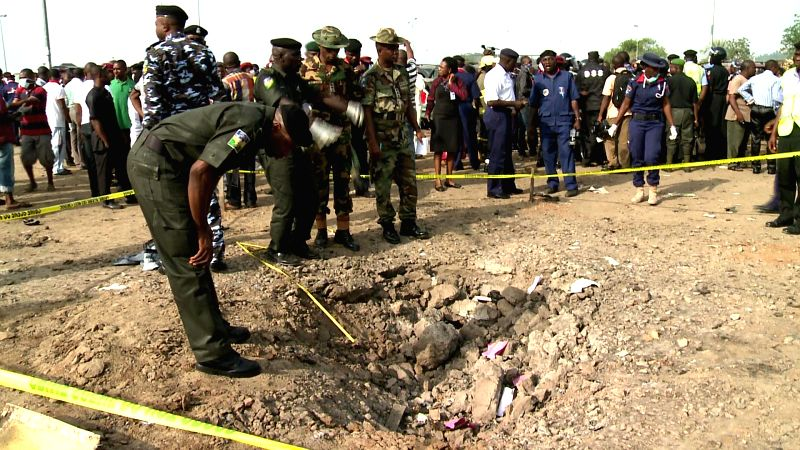 Security personnel inspect the blast site in Nigeria's capital city Abuja on April 14, 2014. 71 people were killed and 124 people were injured in the morning ...