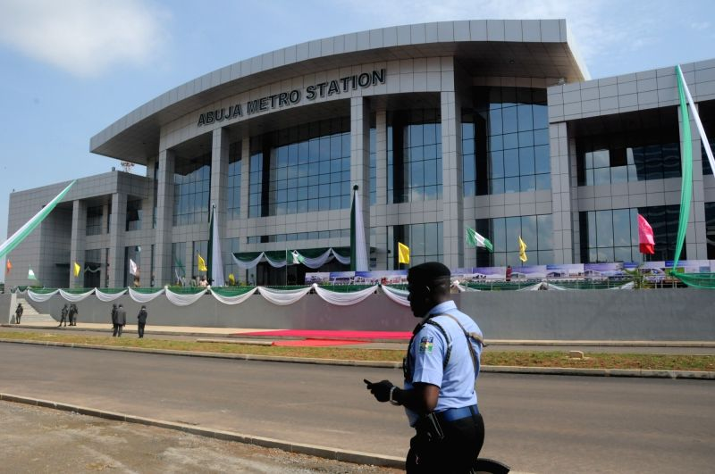 ABUJA, July 13, 2018 - A local policeman walks past the Abuja Metro Station in Abuja, Nigeria, July 12, 2018. Nigeria on Thursday formally commissioned the China-assisted Abuja light rail ...