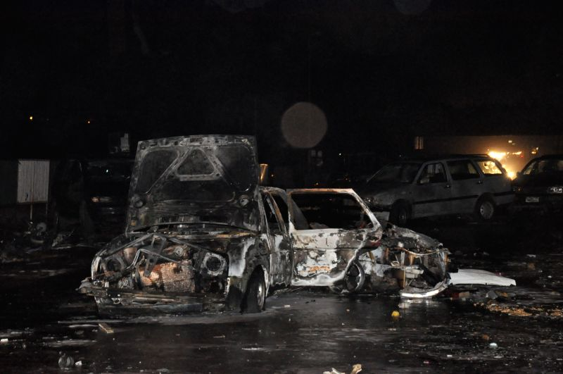 A destroyed car is seen at the blast site in Abuja, capital of Nigeria, May 1, 2014. At least nine people were killed and 11 unconscious victims were rushed to ...