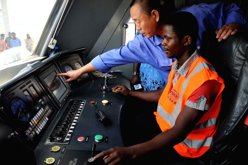 ABUJA, May 12, 2016 - A Chinese train driver teaches a local worker on the train in Abuja, Nigeria on May 12, 2016. A Chinese firm undertaking the construction of Nigeria's first standard gauge ...