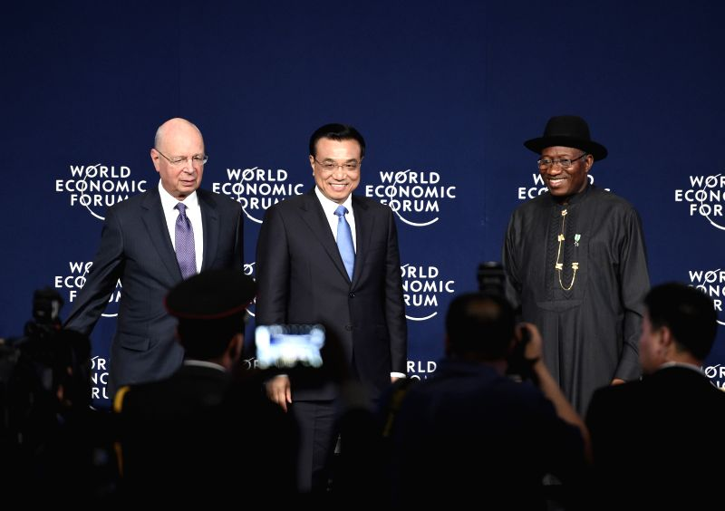 Photo: Chinese Premier Li Keqiang (C) attends the World Economic Forum on Africa in Abuja, Nigeria, May 8, 2014. Photo: (Xinhua/Li Xueren)