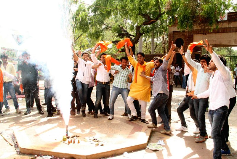 ABVP activists celebrate as Delhi University gave in to the UGC diktat and scrapped the year-old four-year undergraduate programme (FYUP) in New Delhi on June 27, 2014.