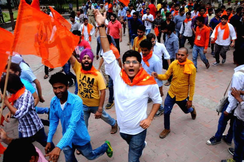 ABVP students celebrate as UGC asked Delhi University to scrap the four-year under-graduate programme in New Delhi on June 23, 2014.