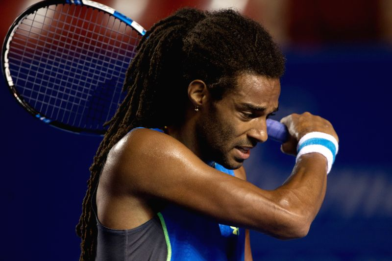 Germany's Dustin Brown reacts during the men's singles match against South Africa's Kevin Anderson at the Abierto Mexicano Telcel tennis tournament in Acapulco, ...