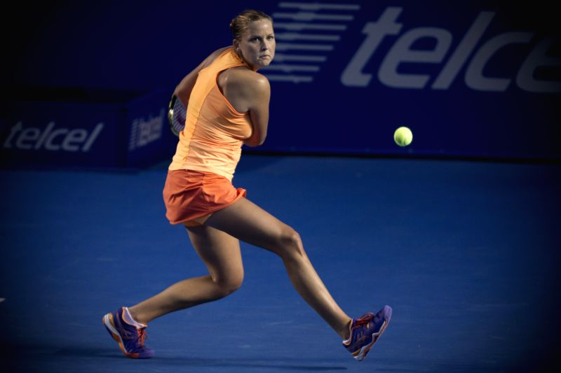 Shelby Rogers of the U.S. returns the ball during the women's single match against Maria Sharapova of Russia at the Abierto Mexicano Telcel tennis tournament in ...