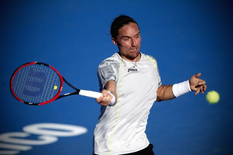 Ukraine's Alexandre Dolgopolov returns the ball during the men's single match against Australia's Sam Groth at the Abierto Mexicano Telcel tennis tournament in ...
