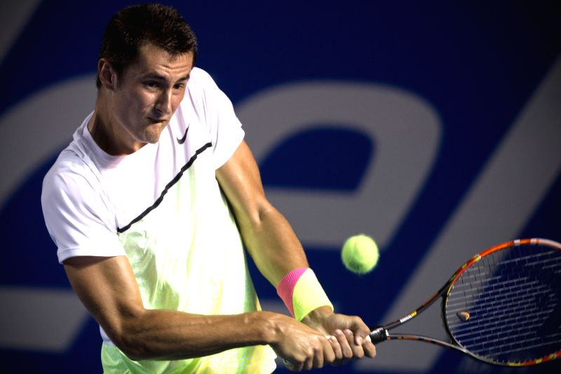Australia's Bernard Tomic returns the ball during the men's singles match against Spain's David Ferrer at the Abierto Mexicano Telcel tennis tournament in ...