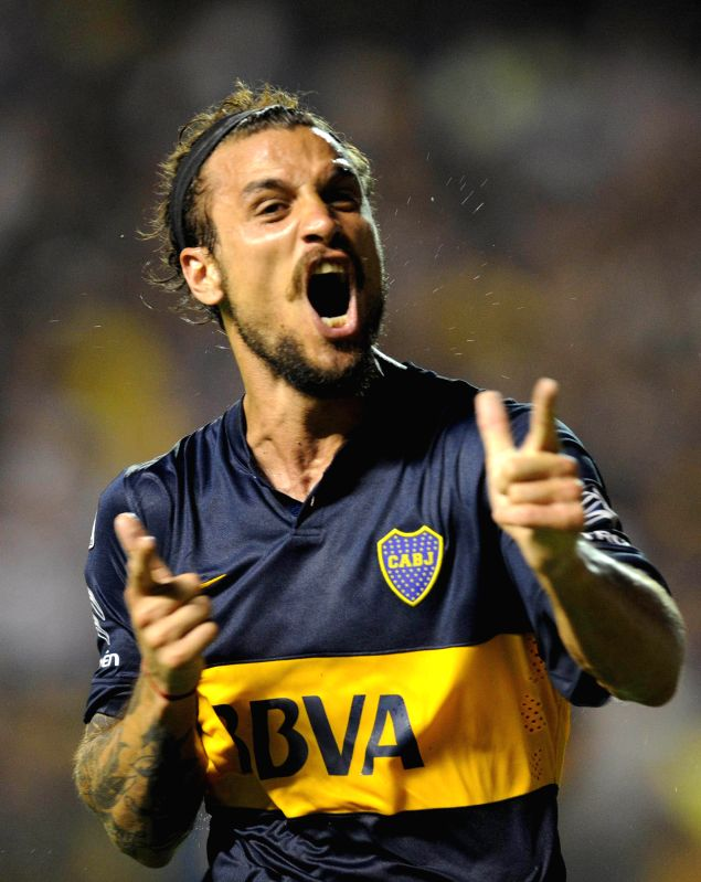 Daniel Osvaldo of Argentina's Boca Juniors celebrates after scoring a goal during a match of the Copa Libertadores against Uruguay's Montevideo Wanderers in Buenos ...