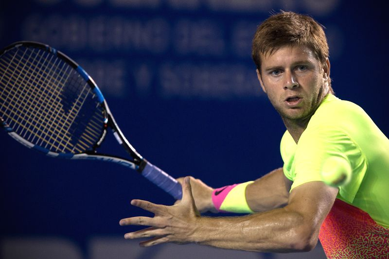 Ryan Harrison of the United States returns the ball during the men's singles match against Croatia's Ivo Karlovic at the Abierto Mexicano Telcel tennis tournament ...