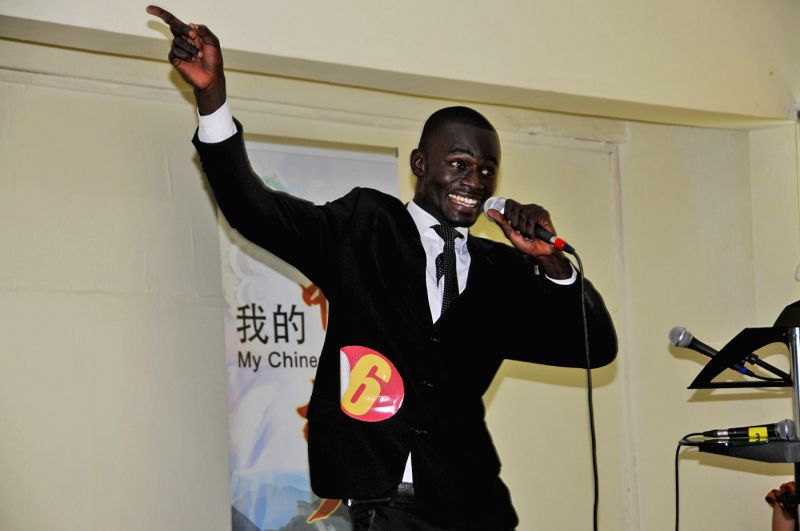 "A student performs during the preliminary contest of Ghana section of The 13th ""Chinese Bridge"" Proficiency Competition on May 17 in Accra, Ghana. The 13th .."
