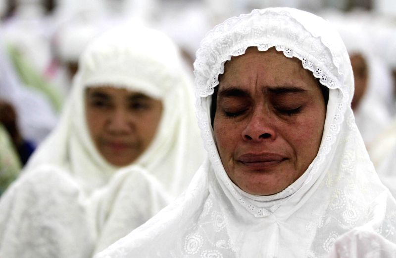 Indonesian Muslim women participate in mass praying during 10-year commemoration of Tsunami at Baiturrahman great mosque in Banda Aceh, Indonesia, Dec. 25, 2014. ...